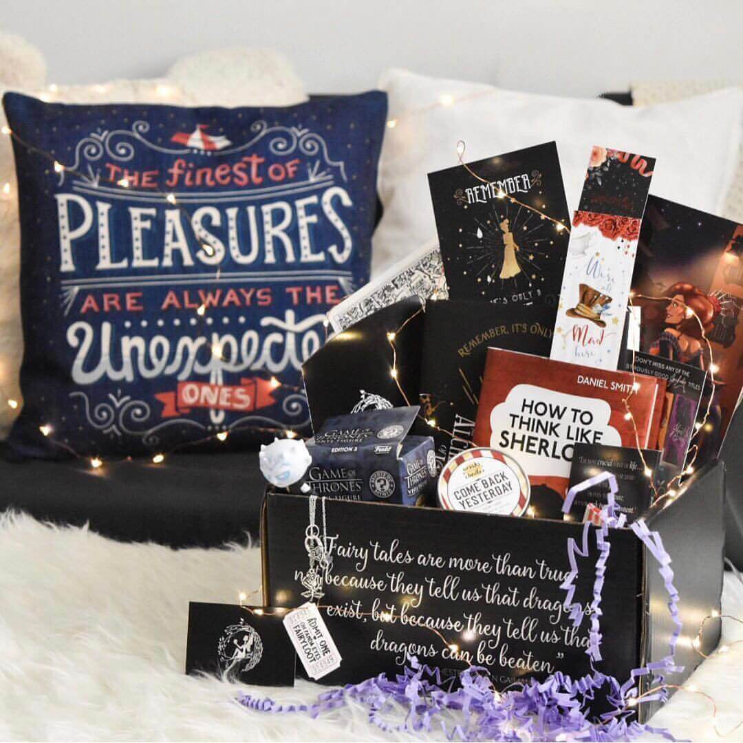 FairyLoot box displayed on a furry rug with twinkle lights, a quote pillow, and all items shown.